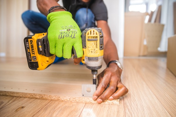 Donate things - Person using impact driver